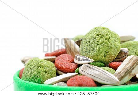 Selective focus and close up / Hamster food in green tray on white background (pets, food, hamster)
