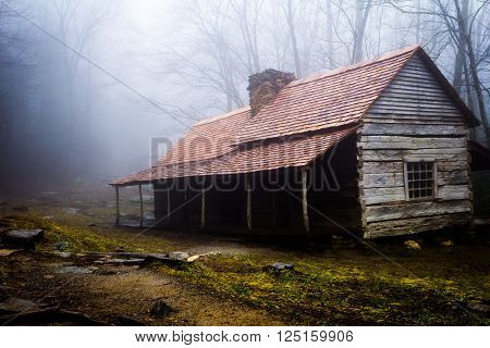 Historic Ogle Farmhouse outside Gatlinburg, Tn. in the Great Smoky Mountains. Built in the mid-1800's. Captured in the early morning with fog rolling from the forest.