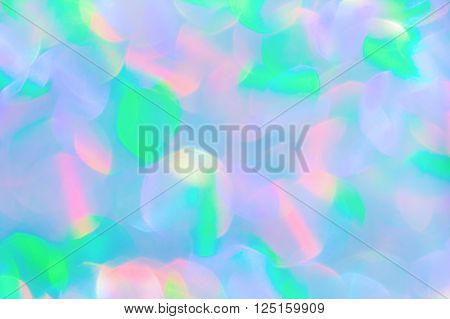 Abstract multicolored iridescent glitter texture background. Holiday background