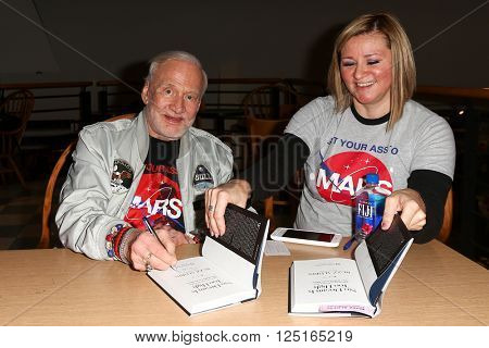 HUNTINGTON, NY-APR 5: Former astronaut Buzz Aldrin (L)  signs his book