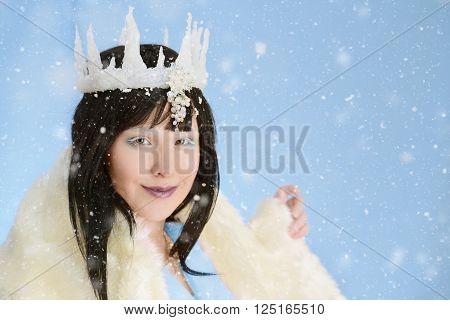portrait of ice queen with fur cloak