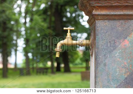 Drinking fountain in a park: water shortage concept image