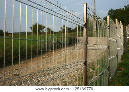 Welded wire fence, metal made for protection.