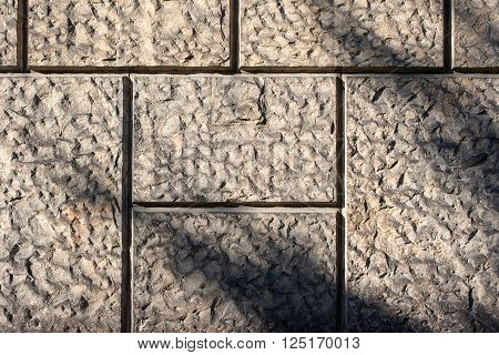 profiled wall of sandstone - texture to background