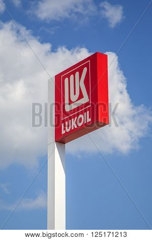 BELGRADE, SERBIA - AUGUST 17, 2014: Logo in front of Lukoil gas station. Headquartered in Moscow Lukoil is the second largest public company in terms of proven oil and gas reserves.