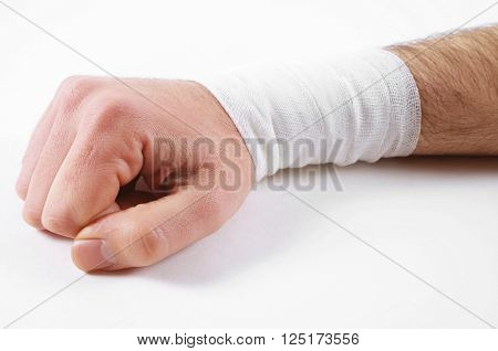 male hand with the bandage on white