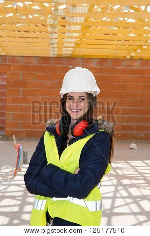 Female architect on construction site supervising building