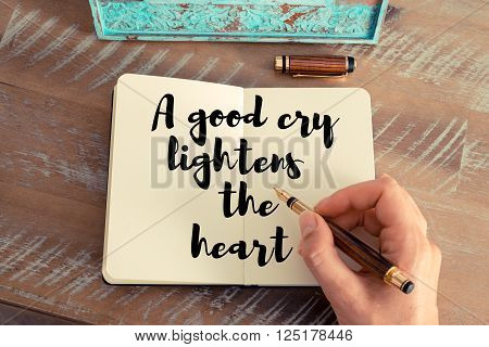 Handwritten quote A good cry lightens the heart