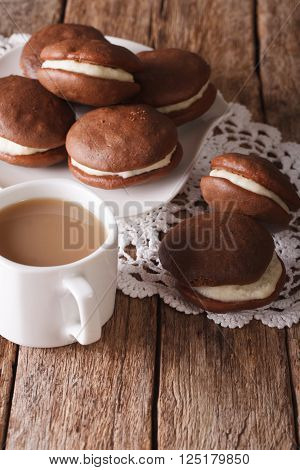 Chocolate Whoopie Pie And Coffee With Milk Close-up. Vertical