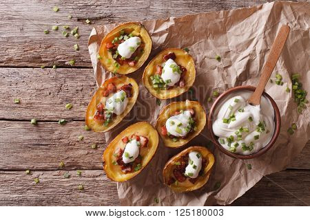 Potato Skins With Cheese, Bacon And Sour Cream On The Table. Horizontal Top View