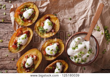 Potato Skins With Cheese, Bacon And Sour Cream Close-up. Horizontal Top View