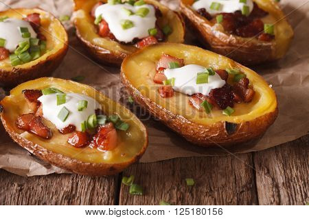Potatoes Stuffed With Cheese, Bacon And Sour Cream Close-up. Horizontal
