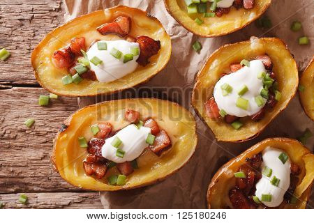 Potato Skins With Cheese And Bacon Close-up On The Table. Horizontal Top View