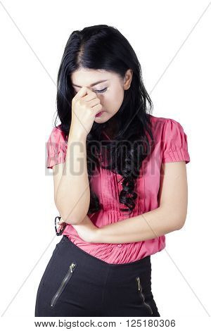 Picture of a young confused businesswoman frowning her forehead in the studio isolated on white background