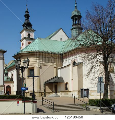 Wieliczka, Poland - April 04, 2016: Sikorskiego street, St. Clement. Church of the fourteenth century, was destroyed by an earthquake in 1782. On its foundations it was built in the early nineteenth century, the present baroque church.