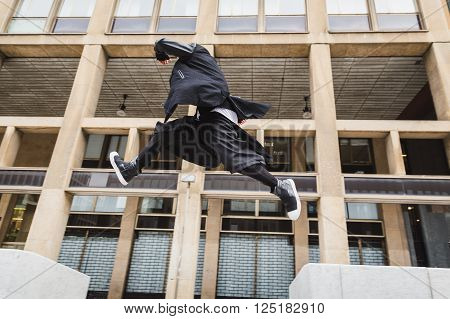 Stylish Bearded Man Jumping In The Street