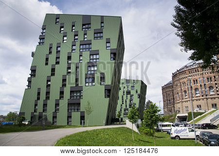 Vienna, Austria - May 7: Modern Buildings In Front Of Gasometers Of Vienna In Austria On 7 May 2012