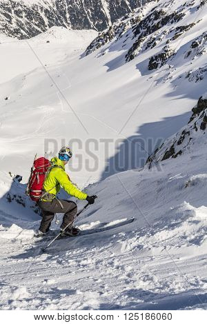 Zakopane, Poland - March 28 2016: Ski mountaineering during downhill skiing in the couloir.