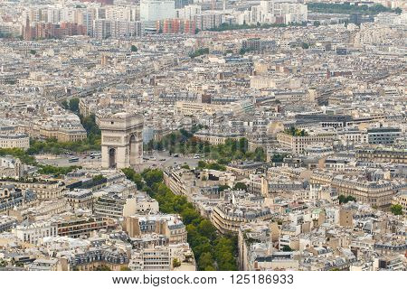 Color DSLR wide angle stock skyline of Paris, France, with the Arc de Triomphe. Urban scene shot from above on top of Eiffel Tower. Horizontal with copy space for text.