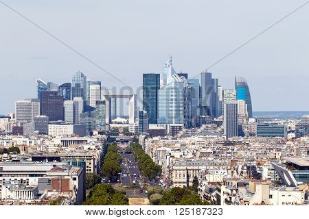 Color DSLR stock image of Paris, France city skyline, including the skyscrapers of neighborhood known as La Defense on the outskirts of the city. Horizontal with copy space for text