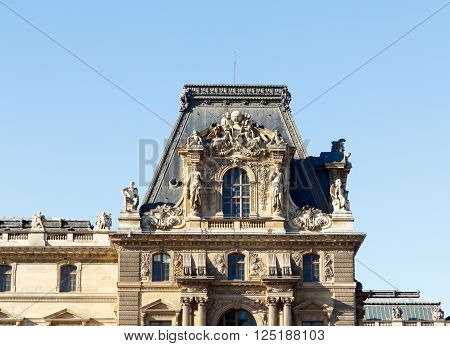 image of ancient, decorative Parisian building, Paris, France.  Horizontal with copy space for text.