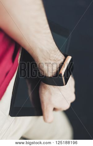 Man Holding A Tablet Pc In A Hand With Smart Watch