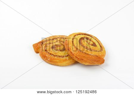 two sweet cinnamon rolls on white background