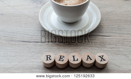Closeup of coffee cup over wooden background