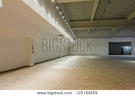 Interior of empty unfinished modern mega market. Architecture concept.