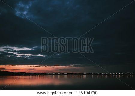 Dramatic sunset over Volga River and Presidental Bridge, located in Ulyanovsk Russia
