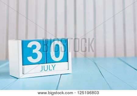 July 30th. Image of july 30 wooden color calendar on white background. Summer day. Empty space for text.