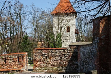 Wieliczka, Poland - April 04, 2016: Saltworks Castle. Fragment of the defensive walls of the fifteenth century. In the middle stands the tower of the fourteenth century.