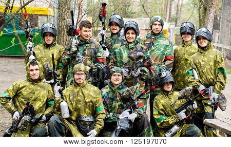 Kiev Ukraine - April 9 2016: Paintball team with guns end equipment