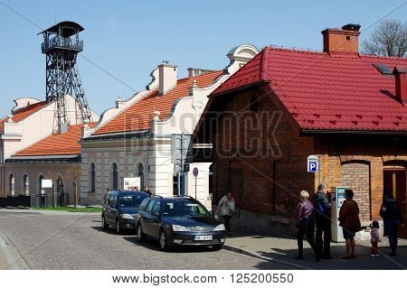 Wieliczka, Poland - April 04, 2016: Zamkowa street Townhouses, some people are walking. On the left