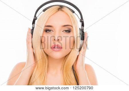 Close Up Portrait Of Relaxed Woman Listening Music In Headphones