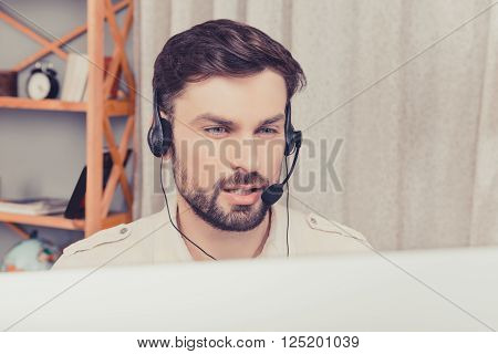Close Up Portrait Of Handsome Young Worker In Head-phones