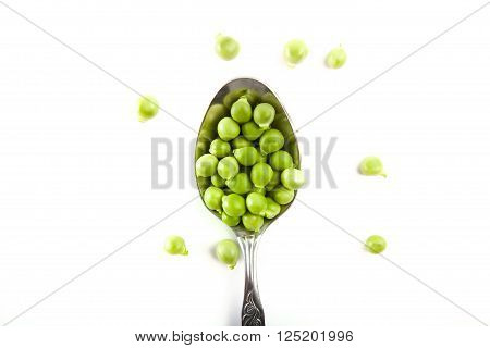 Delicious, Green, Canned Peas In A Silver Spoon On A White