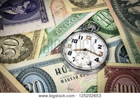 Old hungarian forint money with old pocket watch