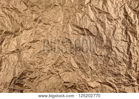 sheet of crumpled parchment paper background. texture of crumpled paper.
