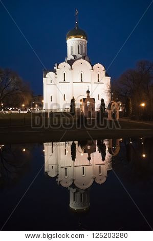 Minsk. Night view at The Church of The Intercession of The Holy Mother of God. Reflection in water