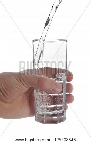 Man's hand holding glass of natural water water flowing into a glass isolated on white background