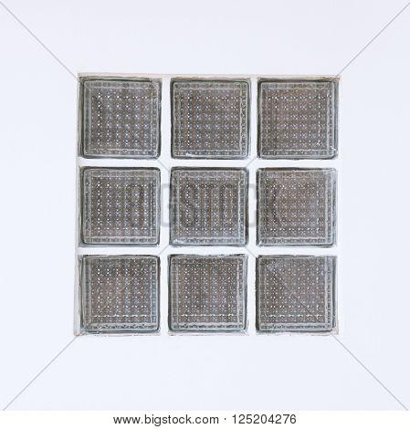 Glass block window on a white wall.