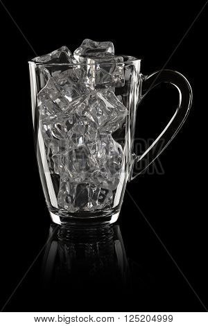Transparent mug with ice cubes on black background