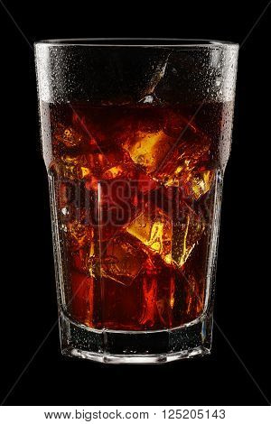 Glass of ice tea with ice cubes on black background. With clipping path