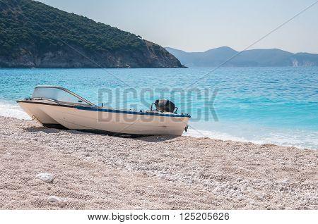 Boat on the Myrtos beach Kefalonia Greece