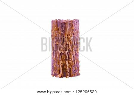 Thick high purple candle  with many wax drips little orange. The wick does not burn. Isolated on white.