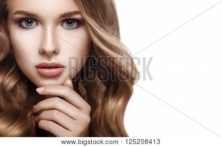 Close-up portrait of a beautiful girl with curly hair, a hand touched his chin. Beauty Girl. Looking at camera. Isolated on white background. Copyspace.