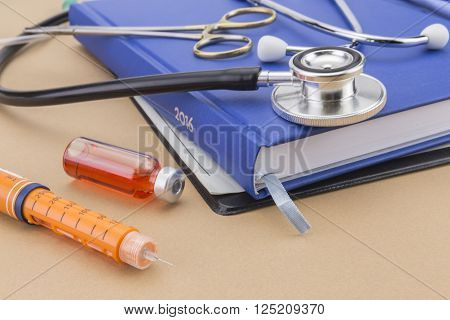 Insulin injecting pen and stethoscope, concept of diabetes