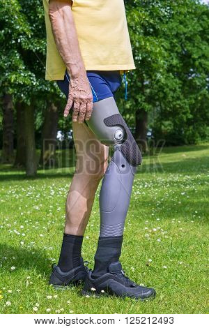 Close Up On Legs Of Man Walking On Grass