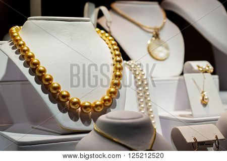 Waikiki, Honolulu, Hawaii, USA - December 14, 2015: Pear jewelries on public display in the evening at Na Hoku, along Kalakaua Avenue. It features the central golden pearl necklace.